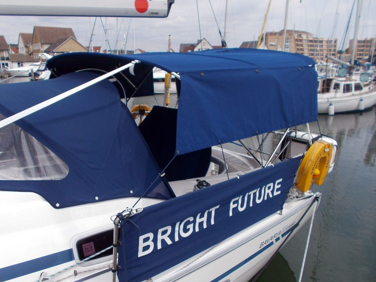 Bavaria 39 Cruiser Bimini shown with optional zip attached Side Shade Curtains