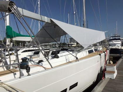 Hanse 588 Sun Awnings fitted on a Hanse 575 left side front view 2