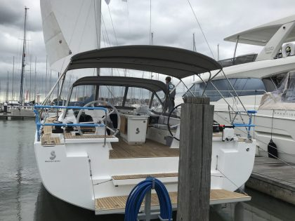 Beneteau Oceanis 51.1, model with NO ARCH, Bimini and zipped Sprayhood Connector rear side view 2
