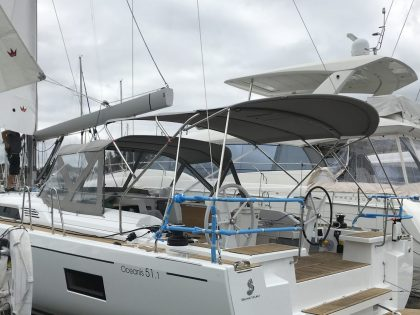 Beneteau Oceanis 51.1, model with NO ARCH, Bimini and zipped Sprayhood Connector rear side view 1