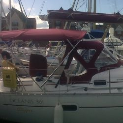 Beneteau Oceanis 361, 4 bar bimini extended aft of backstays_1