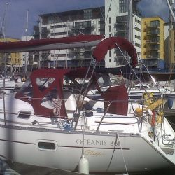 Beneteau Oceanis 361, 4 bar bimini extended aft of backstays_8