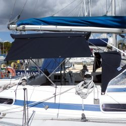 Moody 376 Bimini, standard design shown with optional side shade curtains_1