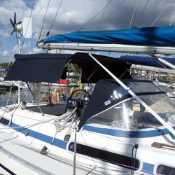 Moody 376 Bimini, standard design shown with optional side shade curtains_3