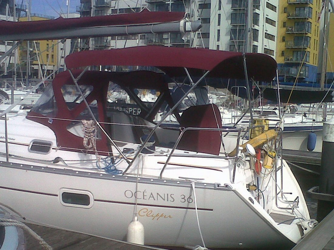 Beneteau Oceanis 361, 4 bar bimini extended aft of backstays
