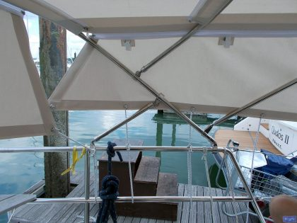 sweden 54 helm bimini with sprayhood connector and side shade panels 11