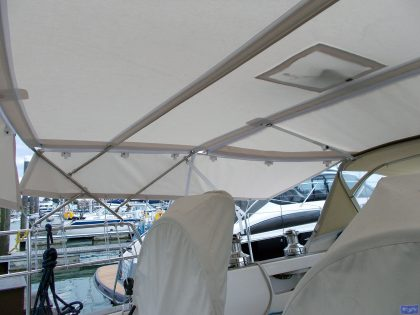 sweden 54 helm bimini with sprayhood connector and side shade panels 7