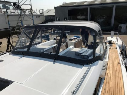 Beneteau Oceanis 51.1, model with NO ARCH, Sprayhood conventional design with NO zipped removable sides front 3