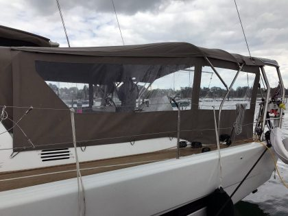 Dufour 56 Bimini utilising fixed gantry with addition of Sprayhood connection panel and side panels left side 2