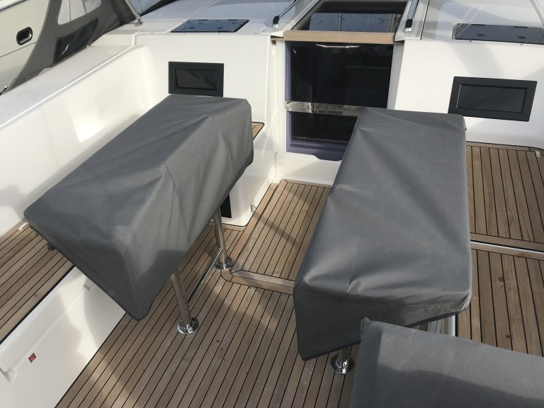 Bavaria Cruiser 45 Style Table Covers with hand rails covered
