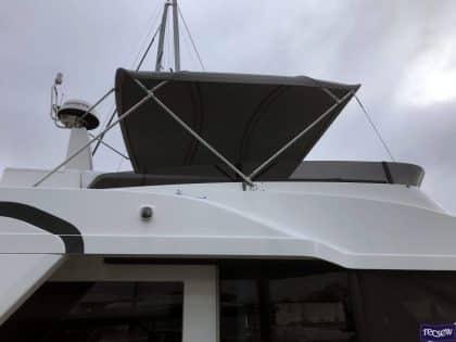 Beneteau Swift Trawler 47 Flybridge Bimini right side view